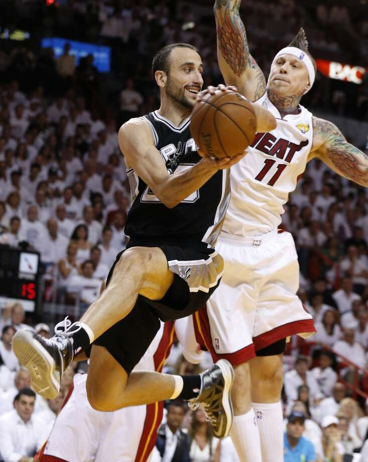 San Antonio Spurs' Manu Ginobili looks dish to a teammate while under pressure from Miami Heat's Chris Andersen during the first half of Game 7 of the 2013 NBA Finals Thursday, June 20, 2013 at American Airlines Arena in Miami. (Edward A. Ornelas/San Antonio Express-News) Photo: Edward A. Ornelas, San Antonio Express-News