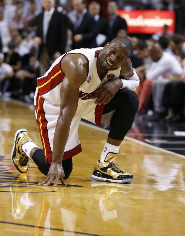 Miami Heat's Dwyane Wade rests during the first half of Game 7 of the 2013 NBA Finals Thursday, June 20, 2013 at American Airlines Arena in Miami. (Edward A. Ornelas/San Antonio Express-News) Photo: Edward A. Ornelas, San Antonio Express-News