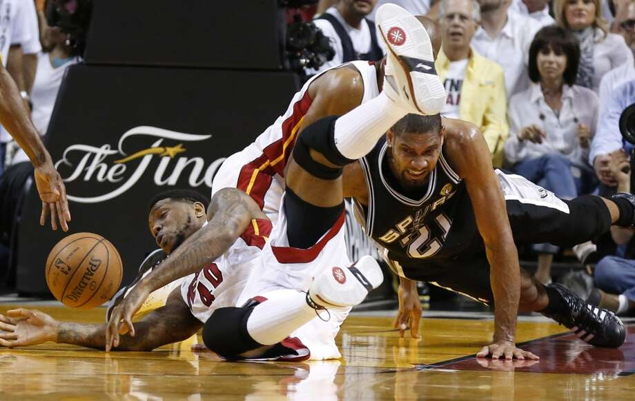 Miami Heat's Udonis Haslem and San Antonio Spurs' Tim Duncan scramble for a loose ball during the first half of Game 7 of the 2013 NBA Finals Thursday, June 20, 2013 at American Airlines Arena in Miami. (Edward A. Ornelas/San Antonio Express-News) Photo: Edward A. Ornelas, San Antonio Express-News