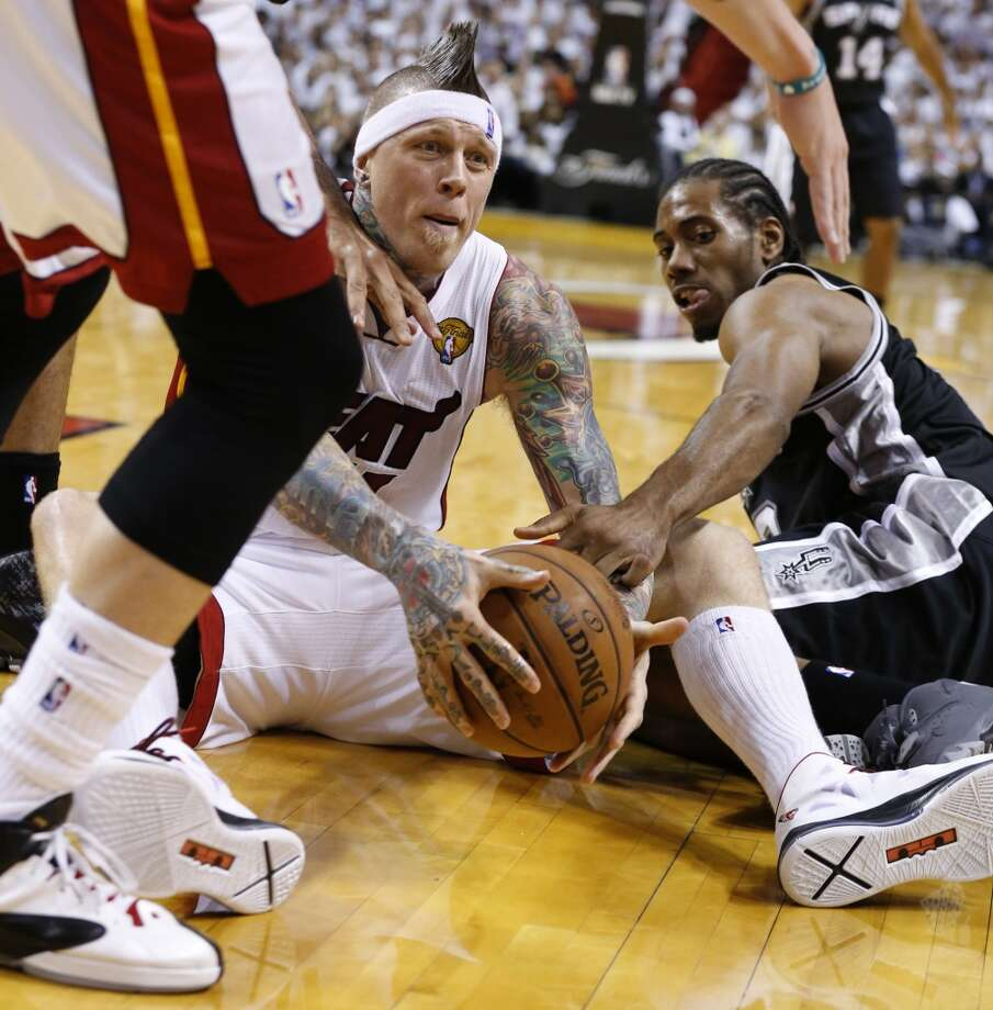 Miami Heat's Chris Andersen and San Antonio Spurs' Kawhi Leonard scramble for a loose ball during the first half of Game 7 of the 2013 NBA Finals Thursday, June 20, 2013 at American Airlines Arena in Miami. (Edward A. Ornelas/San Antonio Express-News) Photo: Edward A. Ornelas, San Antonio Express-News