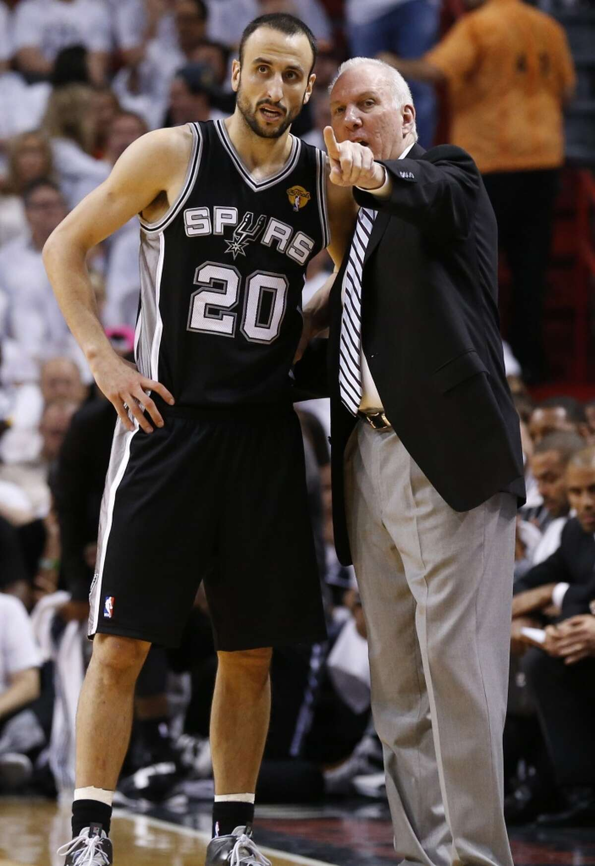 San Antonio Spurs head coach Gregg Popovich talks to Manu Ginobili during the first half of Game 7 of the 2013 NBA Finals Thursday, June 20, 2013 at American Airlines Arena in Miami. (Edward A. Ornelas/San Antonio Express-News)