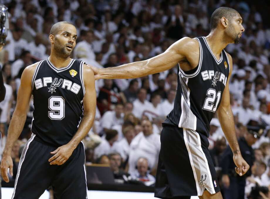 San Antonio Spurs' Tony Parker and Tim Duncan react after a call during the first half of Game 7 of the 2013 NBA Finals Thursday, June 20, 2013 at American Airlines Arena in Miami. (Edward A. Ornelas/San Antonio Express-News) Photo: Edward A. Ornelas, San Antonio Express-News
