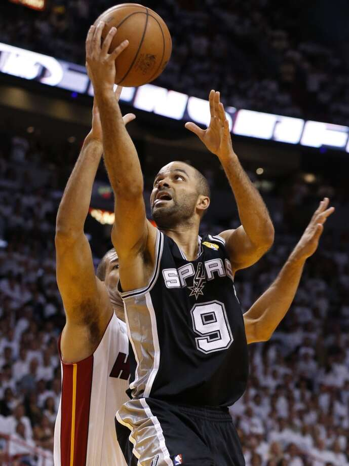San Antonio Spurs' Tony Parker drives past Miami Heat's Mike Miller during the first half of Game 7 of the 2013 NBA Finals Thursday, June 20, 2013 at American Airlines Arena in Miami. (Edward A. Ornelas/San Antonio Express-News) Photo: Edward A. Ornelas, San Antonio Express-News