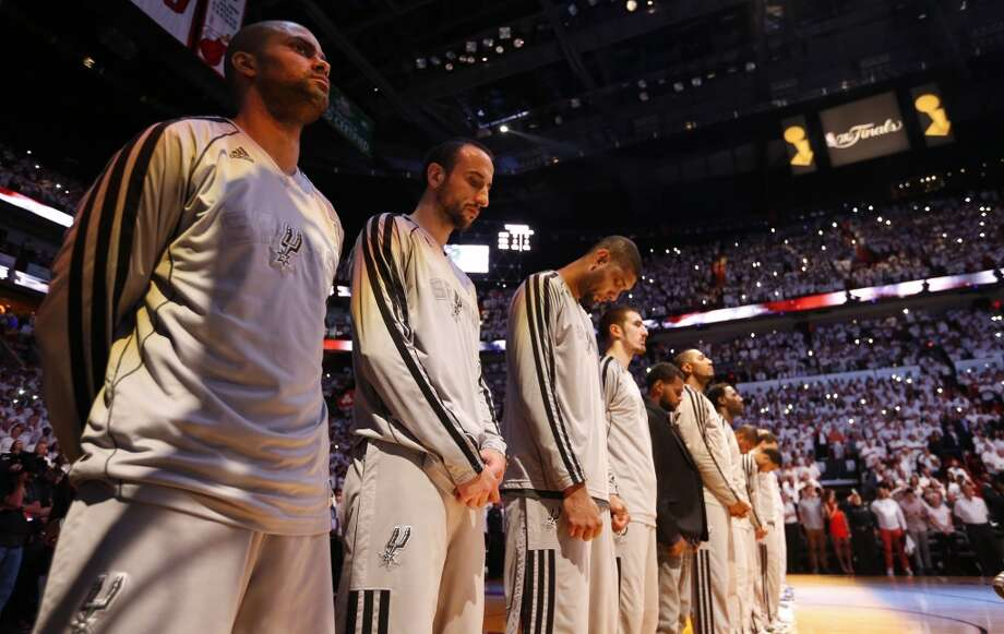 The Spurs stand for the national anthem before the first half of Game 7 of the 2013 NBA Finals Thursday, June 20, 2013 at American Airlines Arena in Miami. (Edward A. Ornelas/San Antonio Express-News) Photo: Edward A. Ornelas, San Antonio Express-News