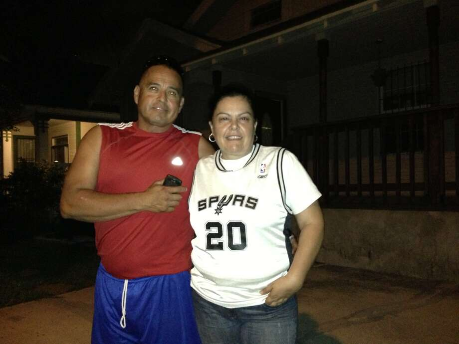 "Nora and Rogelio Garza have been Spurs fan since their '99 championship win. From Coahuila, Mexico, they each moved to San Antonio more than two decades ago and have found a reason to support the team. They reside on Buena Vista street and like to watch the honking cars as they drive by headed to downtown S.A. ""They always play together, support each other and work hard,"" Rogelio said in Spanish. ""That's what's important in a team."" ""It doesn't matter that they lost because they still have the best attitude,"" Nora said in Spanish. ""They will be good from this. That's why I like them the most."" Photo: Daniella M. Diaz / San Antonio Express-News"