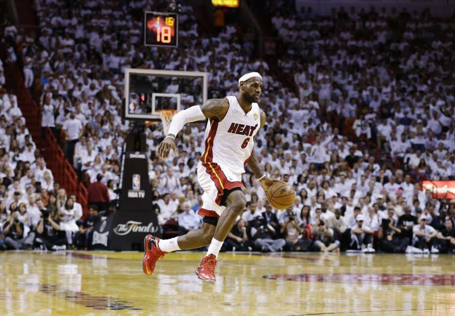 LeBron James takes the ball down court. Photo: Lynne Sladky, Associated Press