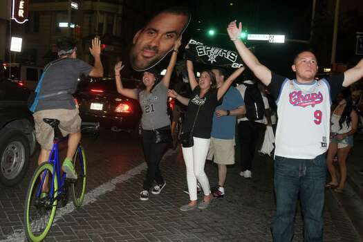 Fans gather in downtown San Antonio after the Spurs lost the NBA Finals against the Miami Heat on Thursday, June 20, 2013. Photo: Abbey Oldham, San Antonio Express-News / © San Antonio Express-News