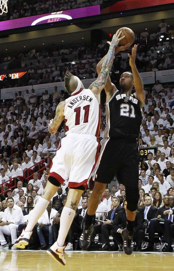 The Heat's Chris Andersen (11) blocks a jump shot by the Spurs' Tim Duncan (21) on Thursday night. Such shot-blocking skill was key to the Heat's success. Photo: Bill Ingram, MBR / Palm Beach Post