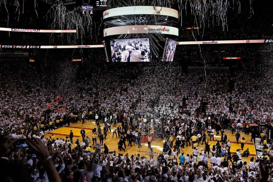 The Miami Heat celebrate after defeating the Spurs to win the 2013 NBA championship. Photo: Kevin C. Cox, Getty Images