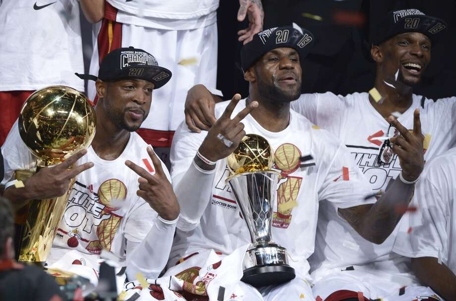"""Miami's """"Big 3"""" of (from left) Dwyane Wade, LeBron James and Chris Bosh included a 27-game winning streak en route to repeating as champions in 2012-13. Photo: BRENDAN SMIALOWSKI, AFP/Getty Images"""
