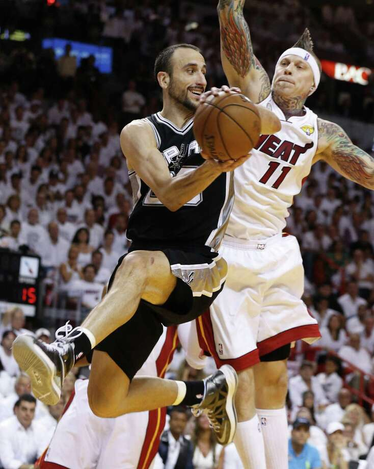 Spurs guard Manu Ginobili looks to pass against the Heat's Chris Andersen. Photo: Edward A. Ornelas / San Antonio Express-News