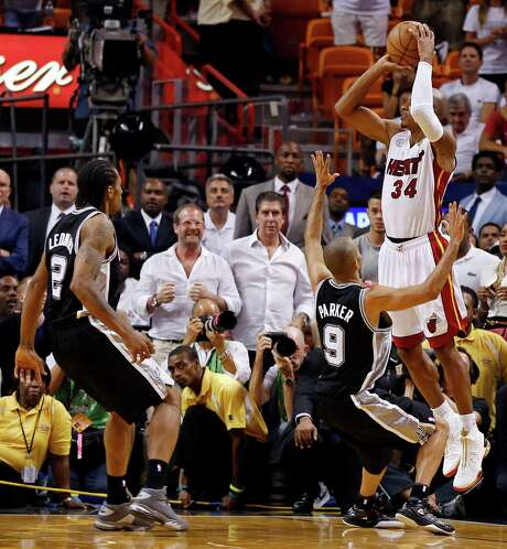 Miami Heat's Ray Allen shoots a 3-pointer to tie the game late in the fourth quarter over San Antonio Spurs' Tony Parker as San Antonio Spurs' Kawhi Leonard looks on in Game 6 of the 2013 NBA Finals Tuesday, June 18, 2013 at American Airlines Arena in Miami. (Edward A. Ornelas/San Antonio Express-News) Photo: San Antonio Express-News / © 2013 San Antonio Express-News