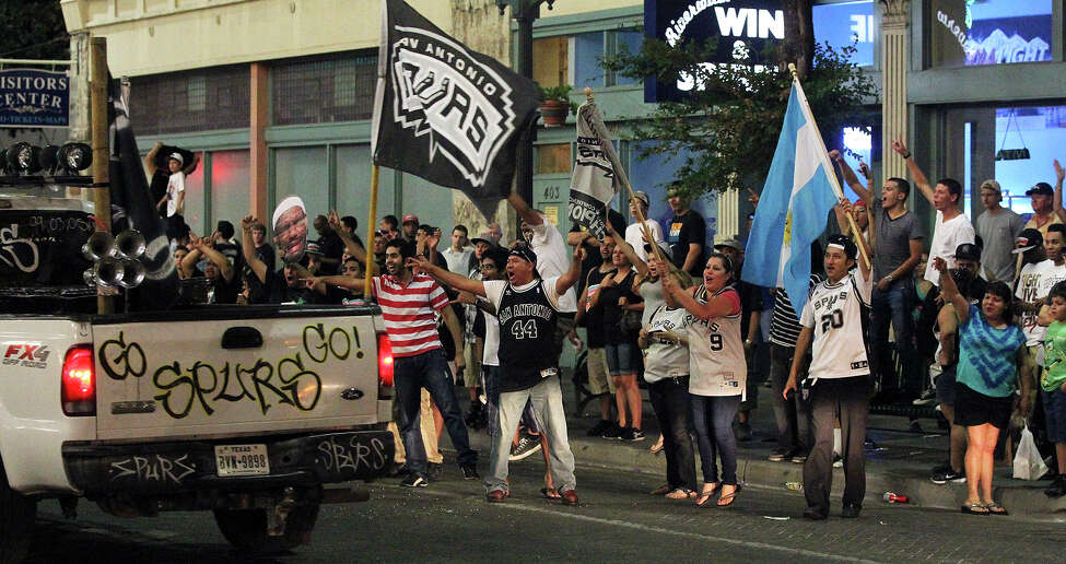 Spurs fans rally on Commerce Street in downtown San Antonio after their team lost in the NBA Finals on June 21, 2013.