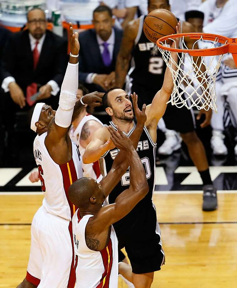 MIAMI, FL - JUNE 20:  Manu Ginobili #20 of the San Antonio Spurs goes up for a shot against LeBron James #6 and Chris Bosh #1 of the Miami Heat in the first quarter during Game Seven of the 2013 NBA Finals at AmericanAirlines Arena on June 20, 2013 in Miami, Florida.   (Photo by Kevin C. Cox/Getty Images) Photo: Kevin C. Cox, Getty Images