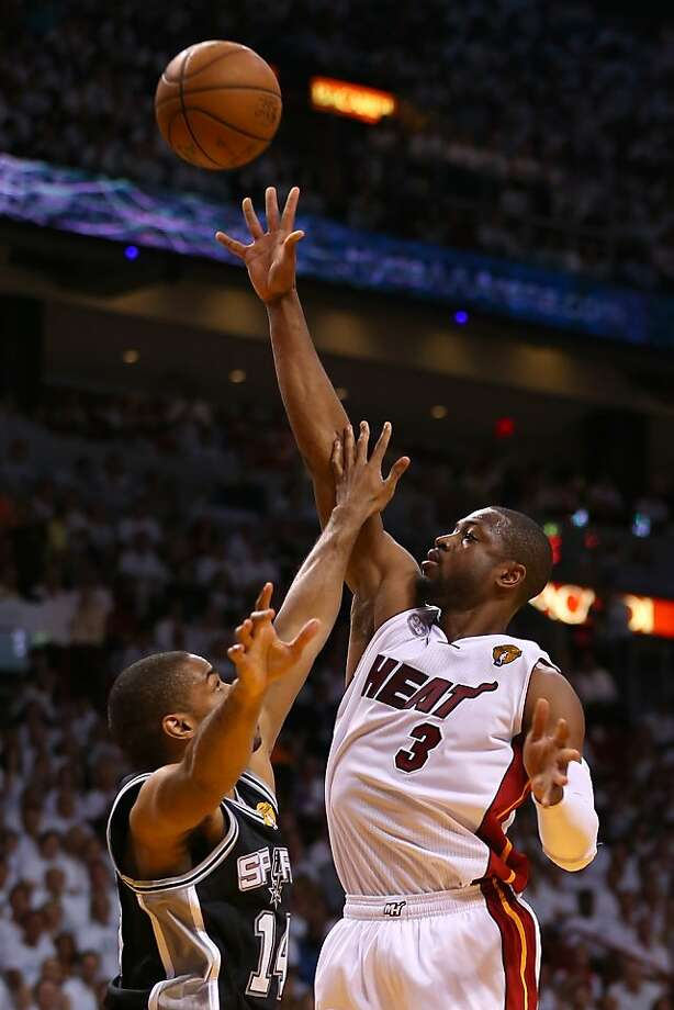 MIAMI, FL - JUNE 20:  Dwyane Wade #3 of the Miami Heat shoots over Tim Duncan #21 of the San Antonio Spurs in the first quarter during Game Seven of the 2013 NBA Finals at AmericanAirlines Arena on June 20, 2013 in Miami, Florida. (Photo by Mike Ehrmann/Getty Images) Photo: Mike Ehrmann, Getty Images