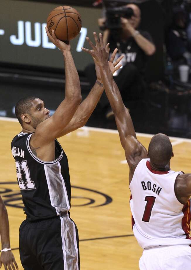 San Antonio Spurs' Tim Duncan shoots overMiami Heat's Chris Bosh during the second half of Game 7 of the NBA Finals at American Airlines Arena on Thursday, June 20, 2013 in Miami. (Kin Man HuiSan Antonio Express-News) Photo: San Antonio Express-News