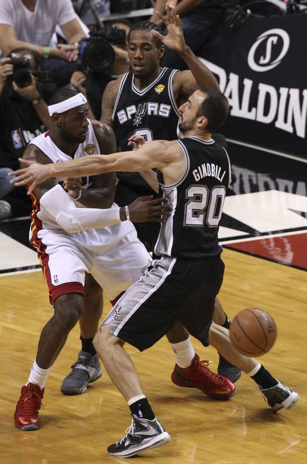 San Antonio Spurs' Kawhi Leonard and Manu Ginobili double team Miami Heat's LeBron James during the second half of Game 7 of the NBA Finals at American Airlines Arena on Thursday, June 20, 2013 in Miami. (Kin Man HuiSan Antonio Express-News) Photo: San Antonio Express-News