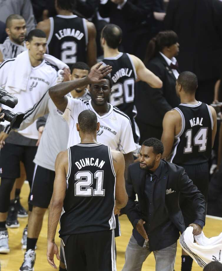 San Antonio Spurs' Tim Duncan is greeted by the team during a time out during the second half of Game 7 of the NBA Finals at American Airlines Arena on Thursday, June 20, 2013 in Miami. (Jerry Lara/San Antonio Express-News) Photo: San Antonio Express-News