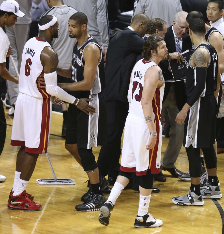 San Antonio Spurs' Tim Duncan pushes Miami Heat's LeBron James away from the Spurs' huddle during the second half of Game 7 of the NBA Finals at American Airlines Arena on Thursday, June 20, 2013 in Miami. (Jerry Lara/San Antonio Express-News) Photo: San Antonio Express-News