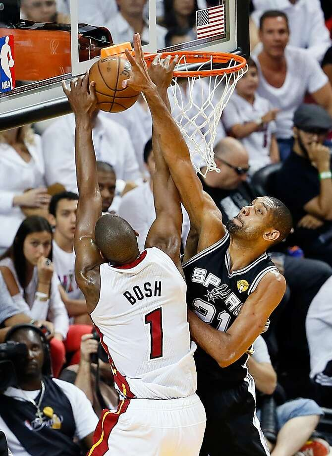 MIAMI, FL - JUNE 20:  Chris Bosh #1 of the Miami Heat goes up for a dunk over Tim Duncan #21 of the San Antonio Spurs in the first half during Game Seven of the 2013 NBA Finals at AmericanAirlines Arena on June 20, 2013 in Miami, Florida. (Photo by Kevin C. Cox/Getty Images) Photo: Kevin C. Cox, Getty Images