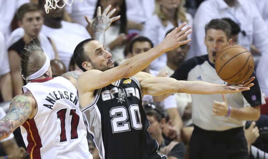San Antonio Spurs' Manu Ginobili tries to do a reverse layup past Miami Heat's Chris Andersen during the second half of Game 7 of the NBA Finals at American Airlines Arena on Thursday, June 20, 2013 in Miami. (Jerry Lara/San Antonio Express-News) Photo: San Antonio Express-News