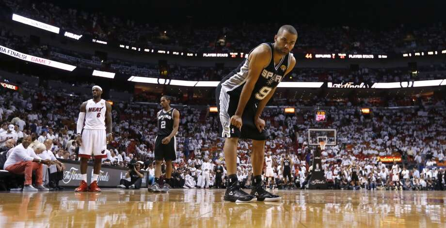 San Antonio Spurs' Tony Parker takes a breather during a break in play during the second half of Game 7 of the 2013 NBA Finals Thursday, June 20, 2013 at American Airlines Arena in Miami. (Edward A. Ornelas/San Antonio Express-News) Photo: San Antonio Express-News