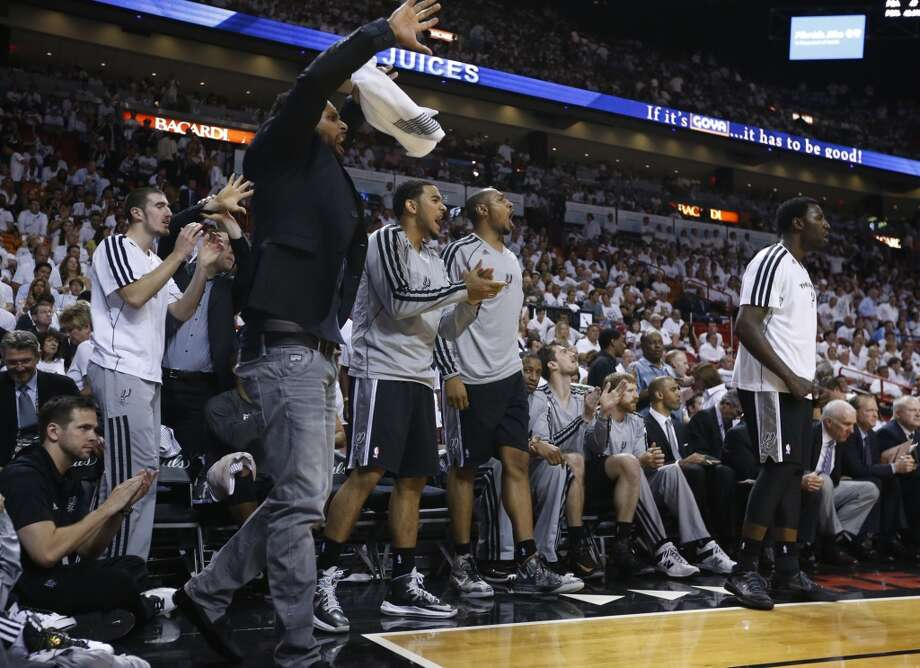 The Spurs bench erupts after a good play during the second half of Game 7 of the 2013 NBA Finals Thursday, June 20, 2013 at American Airlines Arena in Miami. (Edward A. Ornelas/San Antonio Express-News) Photo: San Antonio Express-News