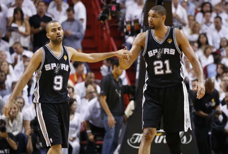San Antonio Spurs' Tony Parker and San Antonio Spurs' Tim Duncan during the second half of Game 7 of the 2013 NBA Finals Thursday, June 20, 2013 at American Airlines Arena in Miami. (Edward A. Ornelas/San Antonio Express-News) Photo: San Antonio Express-News