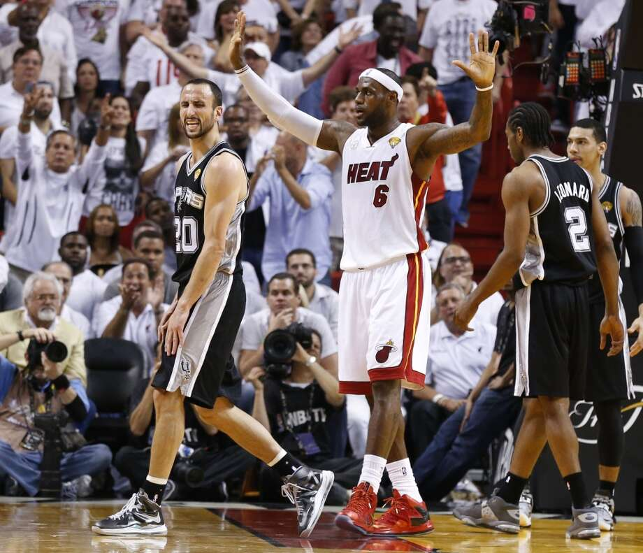 San Antonio Spurs' Manu Ginobili reacts to a call while Miami Heat's LeBron James holds up during the second half of Game 7 of the 2013 NBA Finals Thursday, June 20, 2013 at American Airlines Arena in Miami. (Edward A. Ornelas/San Antonio Express-News) Photo: San Antonio Express-News