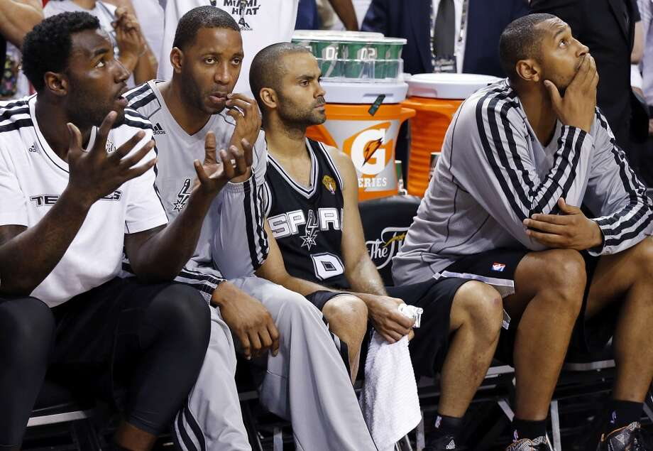 San Antonio Spurs' DeJuan Blair (from left), Tracy McGrady, San Antonio Spurs' Tony Parker and San Antonio Spurs' Boris Diaw sit on the bench late in the fourth quarter in Game 7 of the 2013 NBA Finals against the Miami Heat Thursday, June 20, 2013 at American Airlines Arena in Miami. The Spurs lost the NBA Finals 88-95.  (Edward A. Ornelas/San Antonio Express-News) Photo: San Antonio Express-News