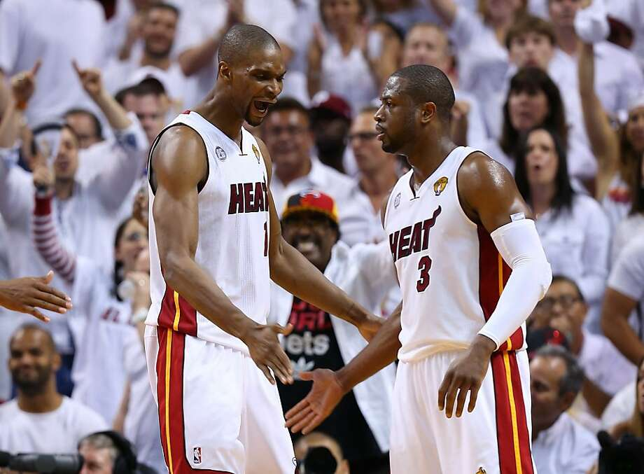 MIAMI, FL - JUNE 20:  Chris Bosh #1 and Dwyane Wade #3 of the Miami Heat celebrate in the second quarter while taking on the San Antonio Spurs during Game Seven of the 2013 NBA Finals at AmericanAirlines Arena on June 20, 2013 in Miami, Florida.   (Photo by Mike Ehrmann/Getty Images) Photo: Mike Ehrmann, Getty Images