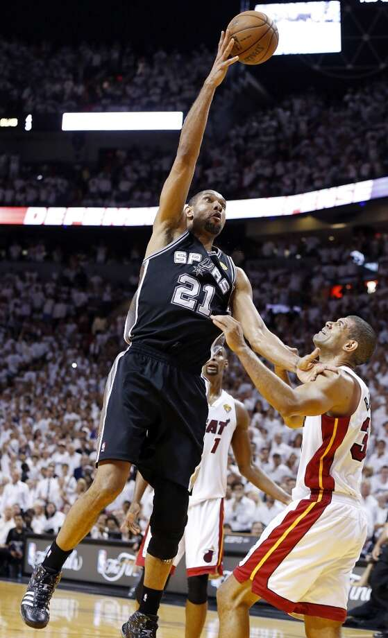 San Antonio Spurs' Tim Duncan shoots his final shot of  Game 7 of the 2013 NBA Finals against Miami Heat's Shane Battier Thursday, June 20, 2013 at American Airlines Arena in Miami. The Spurs lost the NBA Finals 88-95.  (Edward A. Ornelas/San Antonio Express-News) Photo: San Antonio Express-News