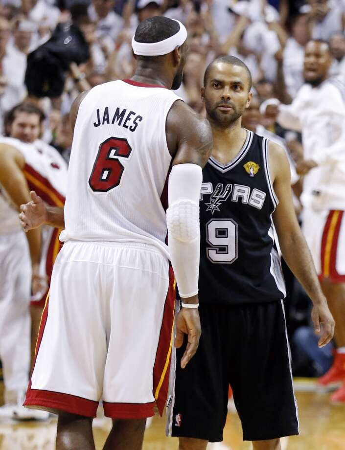 Miami Heat's LeBron James and San Antonio Spurs' Tony Parker hug after Game 7 of the 2013 NBA Finals Thursday, June 20, 2013 at American Airlines Arena in Miami. The Spurs lost the NBA Finals 88-95.  (Edward A. Ornelas/San Antonio Express-News) Photo: San Antonio Express-News