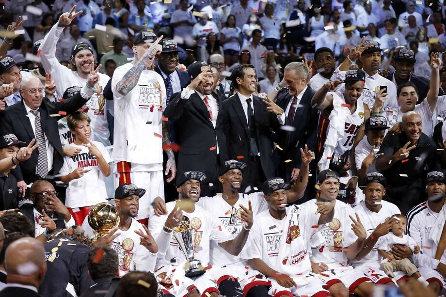 Members of the Miami Heat celebrate after Game 7 of the 2013 NBA Finals against the San Antonio Spurs Thursday, June 20, 2013 at American Airlines Arena in Miami. The Spurs lost the NBA Finals 88-95.  (Edward A. Ornelas/San Antonio Express-News) Photo: San Antonio Express-News