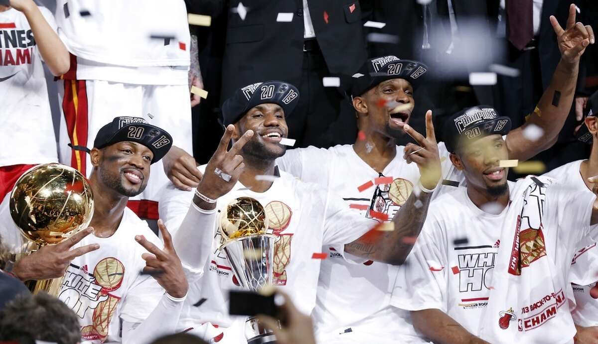 Miami Heat's Dwyane Wade, Miami Heat's LeBron James, Miami Heat's Chris Bosh, and Miami Heat's Norris Cole celebrate after Game 7 of the 2013 NBA Finals against the San Antonio Spurs Thursday, June 20, 2013 at American Airlines Arena in Miami. The Spurs lost the NBA Finals 88-95.