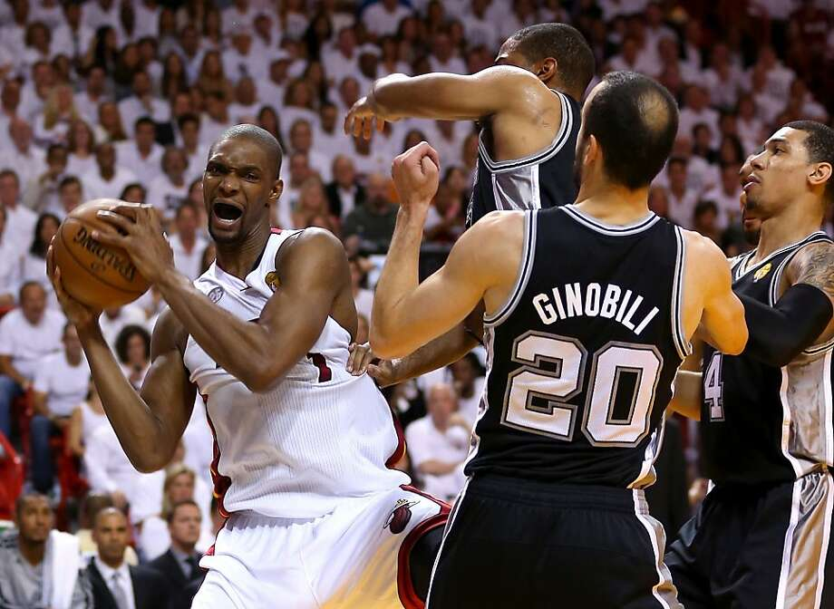 MIAMI, FL - JUNE 20:  Chris Bosh #1 of the Miami Heat with the ball against Tim Duncan #21 and Manu Ginobili #20 of the San Antonio Spurs in the first half during Game Seven of the 2013 NBA Finals at AmericanAirlines Arena on June 20, 2013 in Miami, Florida. (Photo by Mike Ehrmann/Getty Images) Photo: Mike Ehrmann, Getty Images