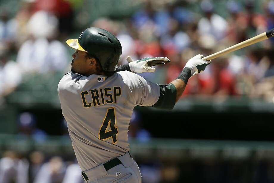 Oakland Athletics center fielder Coco Crisp (4) follows through on a fly out to left in the first inning of a baseball game against the Texas Rangers Thursday, June 20, 2013, in Arlington, Texas. (AP Photo/Tony Gutierrez) Photo: Tony Gutierrez, Associated Press