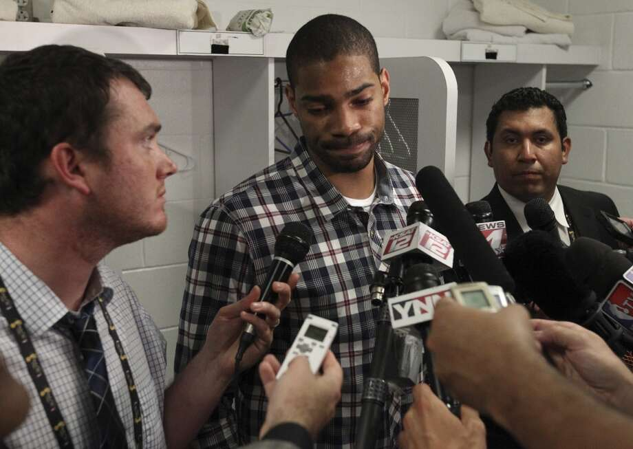 San Antonio Spurs' Gary Neal answers media questions in the locker room after the Spurs' 88-95 loss to the Miami Heat in Game 7 of the NBA Finals at American Airlines Arena on Thursday, June 20, 2013 in Miami. (Kin Man HuiSan Antonio Express-News) Photo: Kin Man Hui, San Antonio Express-News