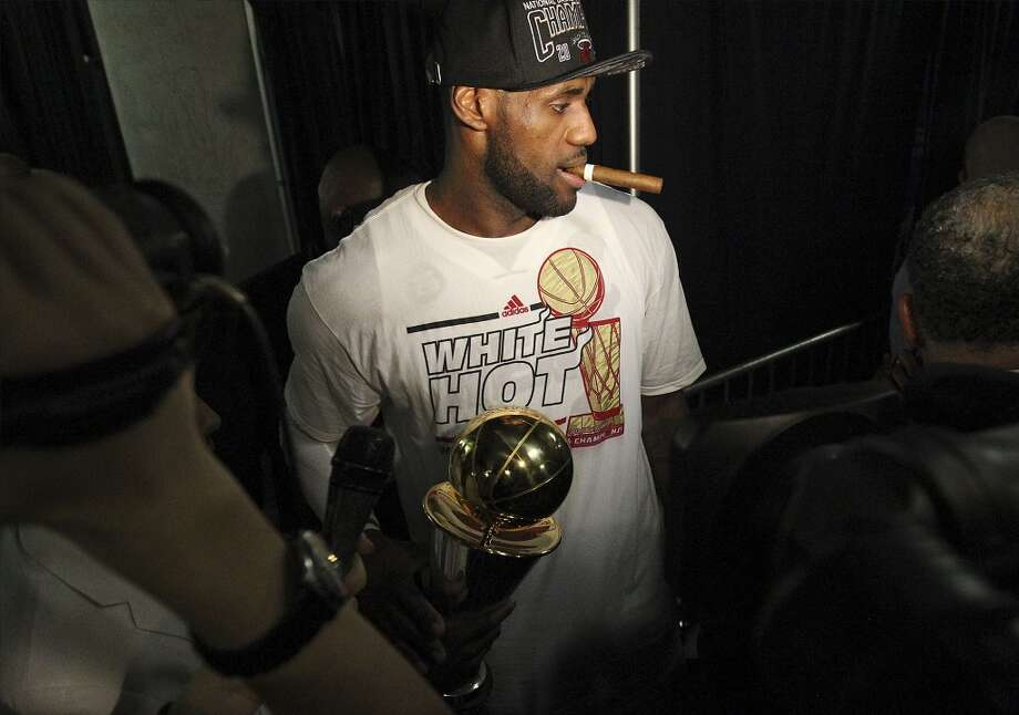 Miami Heat's LeBron James waits to be interviewed after he received the Most Valuable Player award and helped the Miami Heat defeat the Spurs in Game 7 to capture a back-to-back NBA Championship title on Thursday, June 20, 2013. (Kin Man Hui/San Antonio Express-News)_ Photo: Kin Man Hui