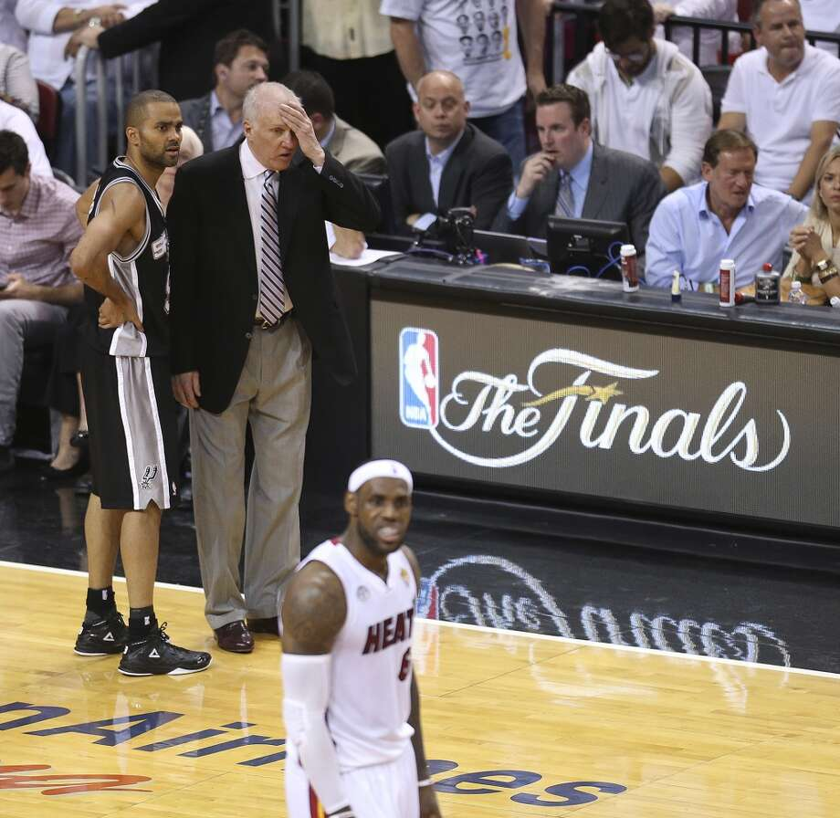 San Antonio Spurs head coach Gregg Popovich reacts while talking with Tony Parker late in the fourth quarter  of Game 7 of the NBA Finals at American Airlines Arena against the Miami Heat  on Thursday, June 20, 2013 in Miami. (Jerry Lara/San Antonio Express-News) Photo: San Antonio Express-News