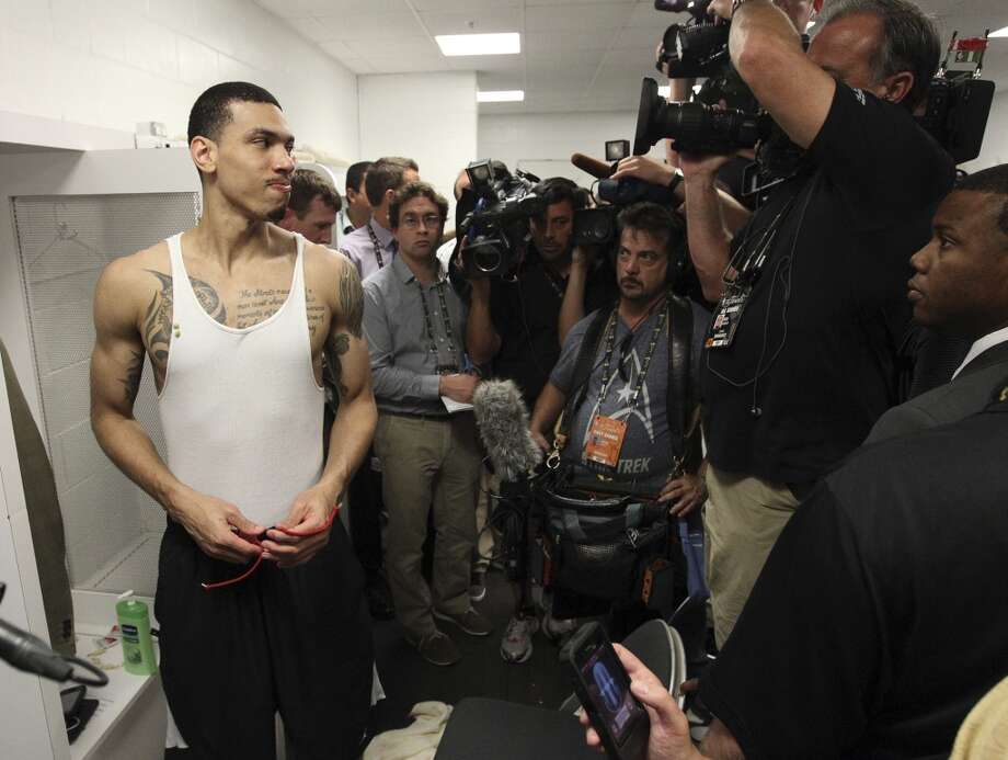 San Antonio Spurs' Danny Green turns to answer media questions in the locker room after the Spurs' 88-95 loss to the Miami Heat in Game 7 of the NBA Finals at American Airlines Arena on Thursday, June 20, 2013 in Miami. (Kin Man HuiSan Antonio Express-News) Photo: San Antonio Express-News