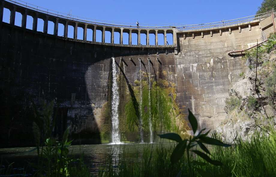 Dam keeper Don Lingenfelter atop  the San Clemente Dam on the Carmel River in Monterey County, Calif. on Wednesday June 19, 2013.  The San Clemente Dam is being removed. It will be the largest dam removal project in California history. The last major dam removal in California was in 1970 - and that was a 50' dam. Since then there's been about 20 dam removals in the state - all 10' high or less. San Clemente is 106' in height. Conservationists hope that it will spur other dam removal projects in the state.