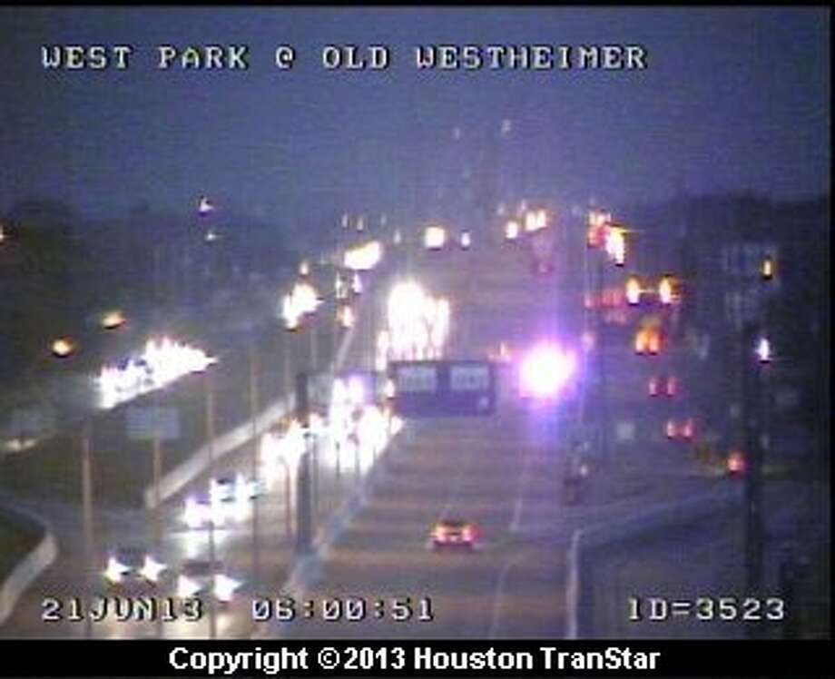 Traffic was snarled on the westbound Westpark Tollway after a crash near Addicks Clodine early Friday morning. Photo: Houston Transtar