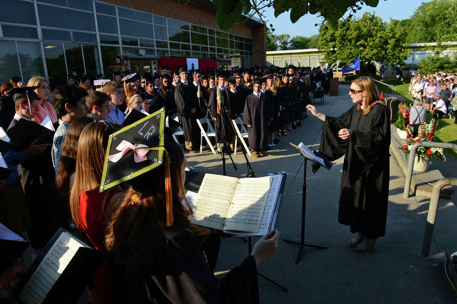 The Fairfield Warde High School Chamber Singers perform America the Beautiful during the school's 9th Annual Commencement Exercises in Fairfield, Conn. on Thursday June 20, 2013. The song was directed by Lauren Harmata. Photo: Christian Abraham / Connecticut Post