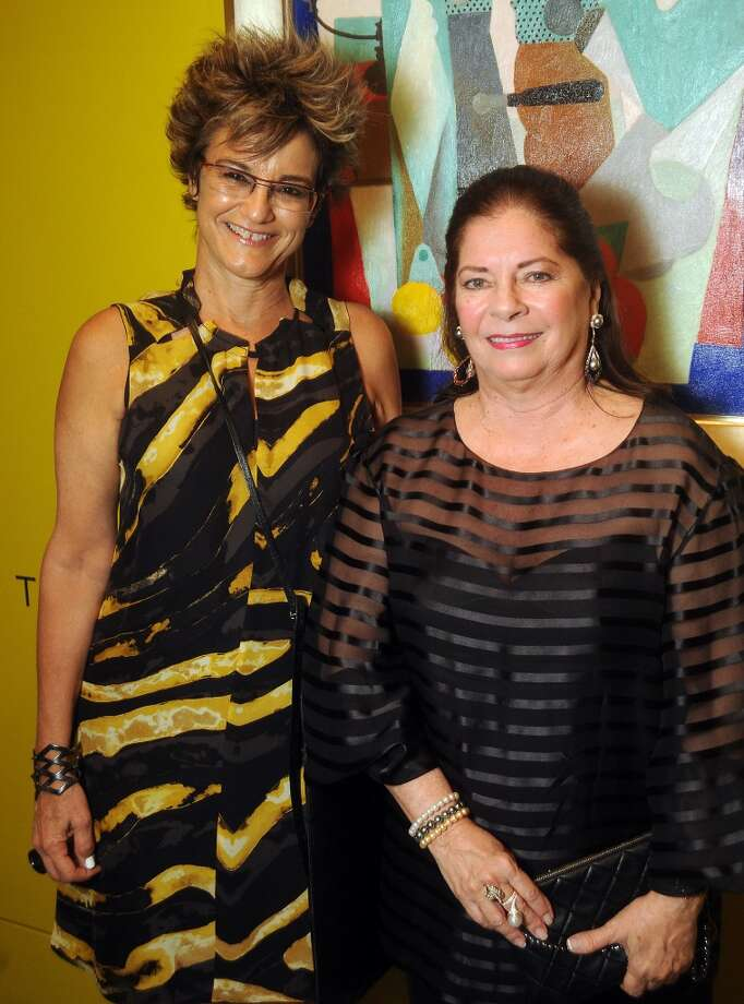 """Curator Mari Carmen Ramirez and Tanya Brillembourg Capriles at a patron's preview dinner for """"Intersecting Modernities: Latin American Art from the Brillembourg Capriles Collection"""" at the Museum of Fine Arts Houston."""