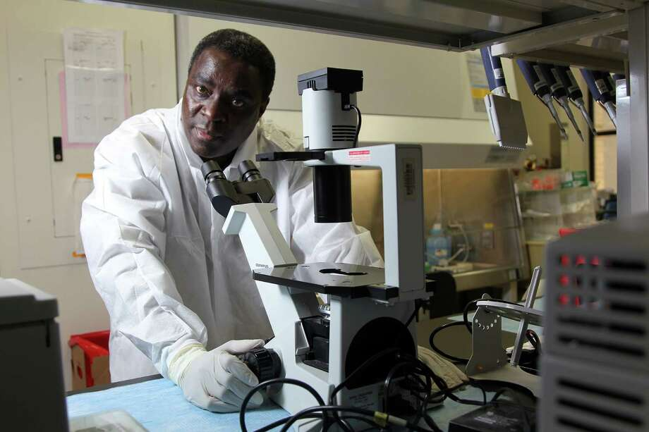 Ndongala Lubaki, a post-doctoral fellow at UTMB Galveston, is part of a team working to find a vaccine for the deadly Ebola virus. In a recent breakthrough, they discovered how the virus shuts down a body's immune system. Photo: Mayra Beltran, Staff / © 2013 Houston Chronicle