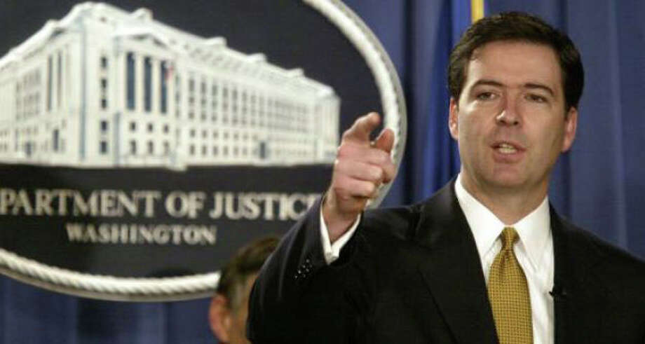 In this Jan. 14, 2004 file photo, then-Deputy Attorney General James Comey gestures during a news conference in Washington. President Barack Obama has nominated the former Bush administration official to head the FBI. Photo: Evan Vucci Photo: Associated Press Photo: Associated Press File / Westport News