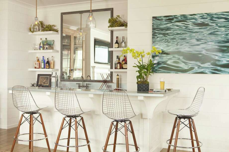 This interior design image released by Lucas Studio, Inc. shows a bar with a beach inspired design. The sun-drenched colors and windswept beachfront textures of summer provide ample inspiration for indoor decorating. Done wrong, a summer-inspired interior can be a tacky, overly tropical disaster. But with a light touch and careful choices, summer can provide ideas for an interior you'll love all year long. (AP Photo/Lucas Studio, Inc., Karyn Millet) Photo: Karyn Millet, HOEP / Lucas Studio, Inc.