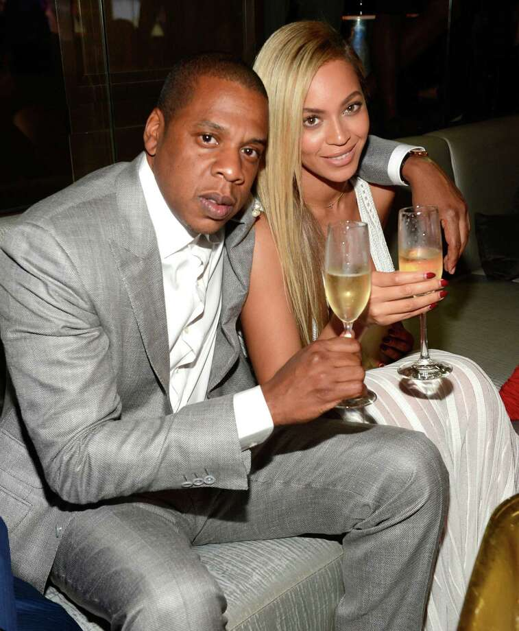 Jay-Z (sitting with Beyoncé) is expanding how he promotes his music through a deal with Samsung. Photo: Kevin Mazur / Getty Images