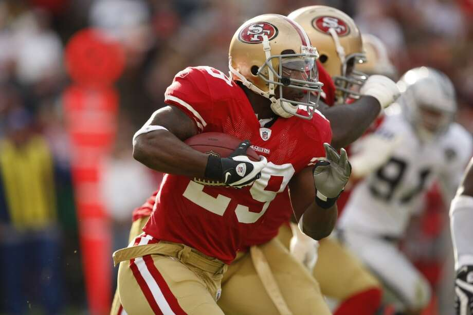 A 2009 file photo showing San Francisco 49ers running back Glen Coffee (29) carrying the ball in the first quarter during the Oakland Raiders in a preseason football game in San Francisco, Calif.